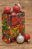 Colorful christmas gift bag filled with christmas baubles Royalty Free Stock Photos