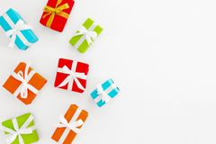 Colorful Christmas gifts boxes on white backgrond. stock photography