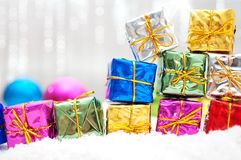 Colorful christmas gifts in snow Royalty Free Stock Photography