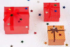 Colorful christmas gifts in snow Stock Photo