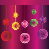 Colorful Christmas globes and stars. Suspended Christmas globes and stars with different colors, on dark purple background Stock Image