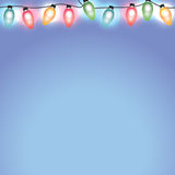Colorful Christmas Holiday Lights on Blue Background Royalty Free Stock Image