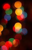 Colorful Christmas lights. Blurred colorful Christmas lights in front of dark background Stock Images