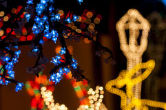 Colorful christmas lights. Blury white lights_red bright balls behind Stock Images