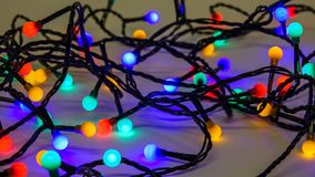 Colorful christmas lights. Messy tangled cables stock images