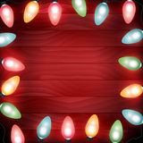Colorful Christmas Lights on Red Wooden Background Illustration. A strand of colorful Christmas lights illuminated around a red wooden background. Vector EPS 10 Royalty Free Stock Images