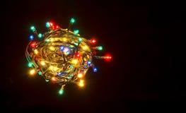 Colorful christmas lights. Shiny leds. Over black royalty free stock photo