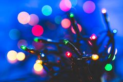 Colorful Christmas lights with bokeh. Colorful Christmas lights with some bokeh in background, in many different colors Royalty Free Stock Images