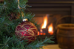Colorful Christmas Ornament. Hanging on a tree with fireplace in background stock images