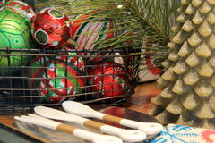 Colorful Christmas ornaments in basket Stock Images