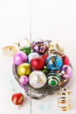 Colorful Christmas ornaments over white background Royalty Free Stock Photos