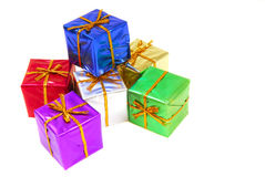 Colorful Christmas presents. Several colorful Christmas presents with gold ribbon stock photo