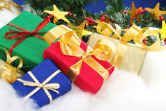 Colorful Christmas Presents. With christmas decoration on cotton (Selective Focus, Focus on the blue and red boxes royalty free stock images