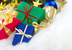 Colorful Christmas Presents. With christmas decoration on cotton (Selective Focus, Focus on the blue box stock photo