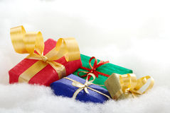 Colorful Christmas Presents. Colorful Christmas gifts on white cotton that looks like clouds (Selective Focus, Focus on the blue and golden gift boxes stock image