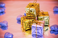 Colorful Christmas presents. Christmas gift decorations with reflection stock photo