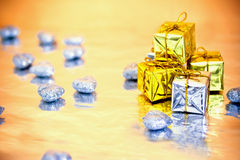 Colorful Christmas presents. Christmas gift decorations with reflection stock photography