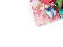 Colorful christmas presents. Closeup of a pile of colorful gift boxes with beautiful decorations, framed in the right corner of the image, isolated on white stock images