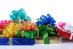 Colorful Christmas presents. Stacked together on white stock image
