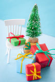 Colorful christmas presents. Colorful christmas boxes with ribbons on a small chair royalty free stock photos