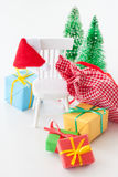 Colorful christmas presents. Colorful christmas boxes with ribbons on a small chair stock photos