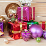 Colorful christmas presents. Colorful presents and shiny ornaments for christmas royalty free stock images