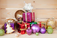 Colorful christmas presents. Colorful presents and shiny ornaments for christmas stock image