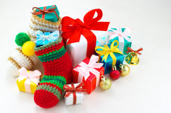 Colorful Christmas presents. Small presents, Christmas stockings and Christmas balls royalty free stock photos