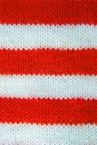Colorful christmas red, white knitted pattern of Santa claus helper hat. royalty free stock photo