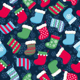 Colorful christmas socks and snowflakes seamless pattern. Stock Images