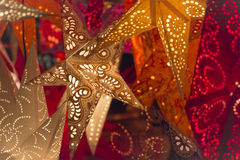 Colorful christmas stars. Shiny red orange golden stars at european christmas market. Part of series Stock Photos