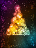 Colorful Christmas tree made of light dots. Light dots of in shades of red, yellow, golden to green blue forming a sparkling Christmas tree embellished with stock illustration
