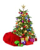 Colorful Christmas tree with Santa's bag and gifts Stock Photography