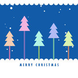 Colorful Christmas tree and snow. With blue background, Greeting card background Royalty Free Stock Image