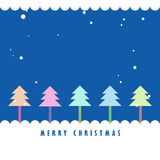 Colorful Christmas tree and snow with blue  sky. Greeting card background Stock Photography