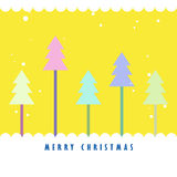 Colorful Christmas tree with yellow background stock photo