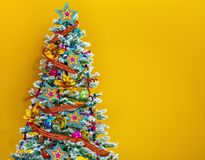 Colorful Christmas tree  on yellow background Royalty Free Stock Image