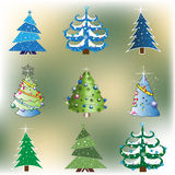 Colorful Christmas trees Stock Images