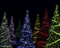 Colorful Christmas trees royalty free stock photos