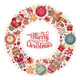 Colorful Christmas wreath with Christmas toys. Royalty Free Stock Photo