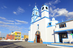 Colorful Church, Mexico. Colorful Church with blue sky background located near borders of Veracruz and Puebla, close to Pico de Orizaba, Iztaccihuatland Royalty Free Stock Images