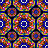 Colorful circle flower mandalas. Geometric seamless pattern in blue red yellow and orange vector illustration