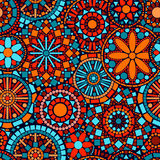 Colorful circle flower mandalas seamless pattern i. Colorful circle flower mandalas ornate seamless pattern in blue red and orange, vector background stock illustration