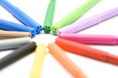 Colorful markers on white background royalty free stock photography