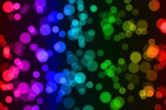 Colorful circle pattern on black background. Rainbow colors. Abstract geometric background texture vector illustration