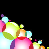 Colorful circles. Bubbles of various colors on a black background. Copy space is at the top right Royalty Free Stock Photography