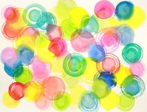 Abstract watercolor circles painting. Colorful circles hand painted in watercolor dancing on white paper, spring and sumer colors Royalty Free Stock Photos