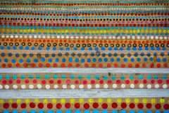 Colorful circles painted on the wooden stairs.  royalty free stock photo