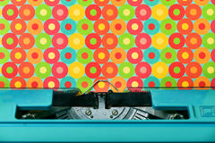 Colorful circles-patterned paper in a blue typewriter Stock Images