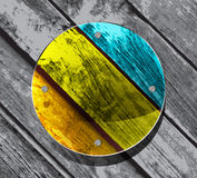Colorful circular plate on the wooden planks Royalty Free Stock Image